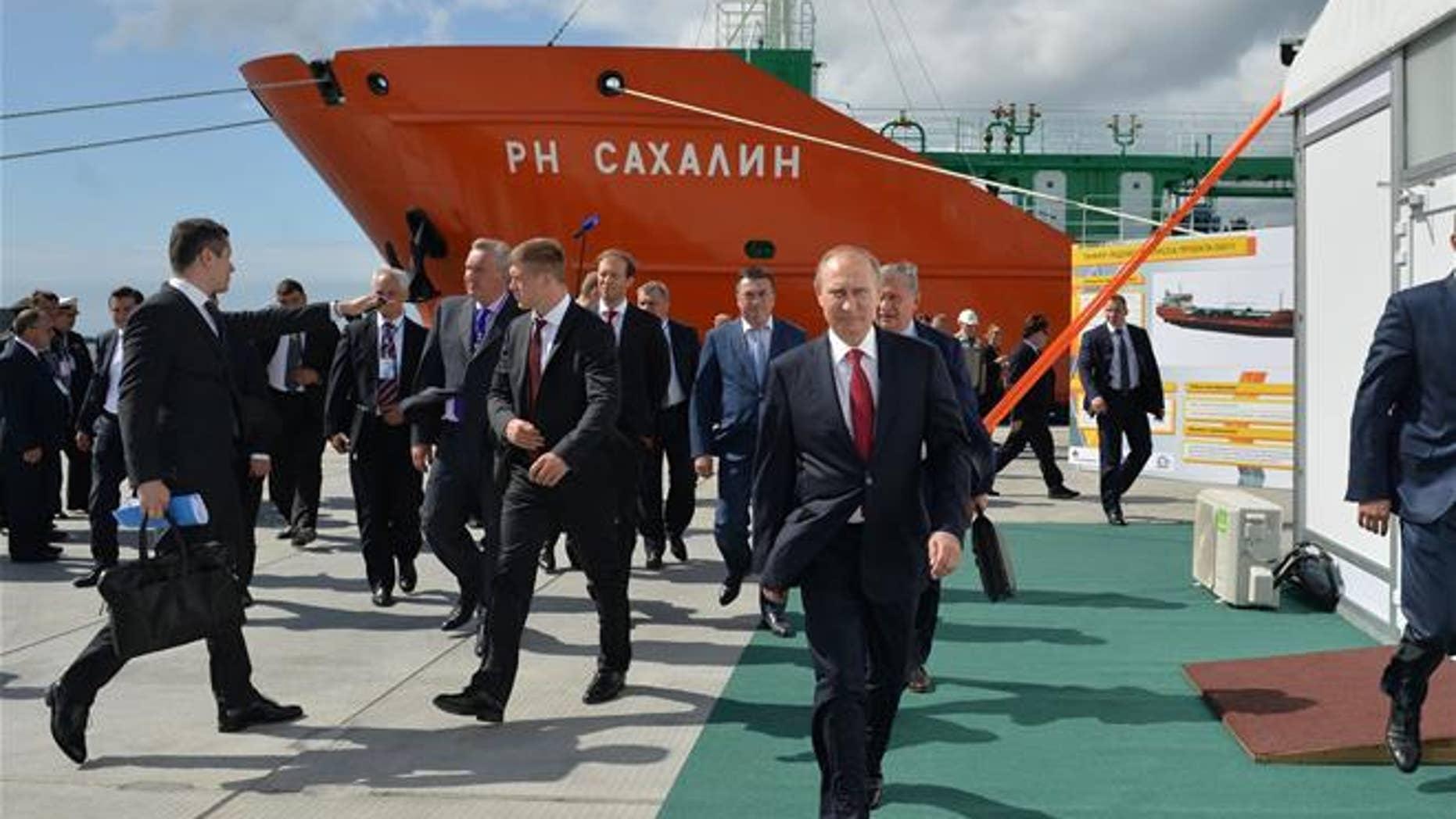 Russian President Vladimir Putin, foregound, walks in the Far Eastern port of Bolshoi Kamen, Russia, on Sept. 1, 2016.