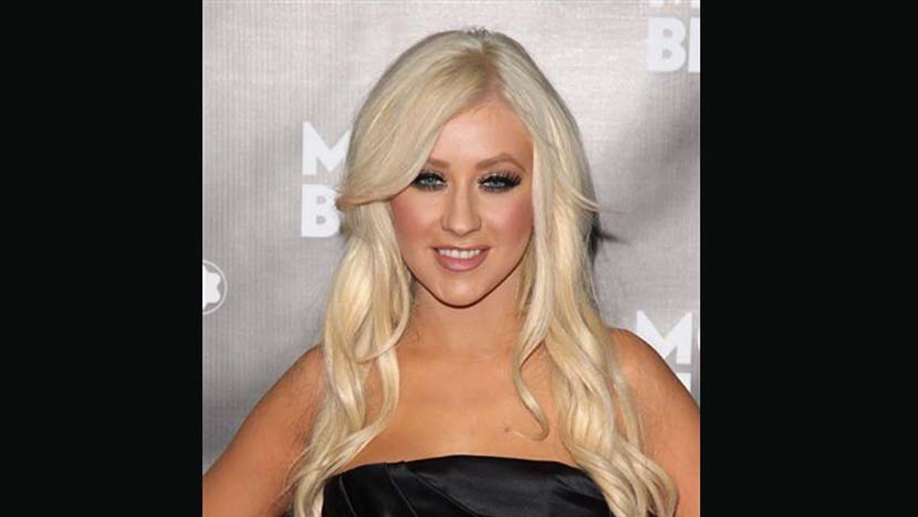 Christina Aguilera asiste al lanzamiento del instrumento de escritura John Lennon de Montblanc, el 12 de septiembre del 2010 en Nueva York. La cantante develará una estrella en el Paseo de la Fama de Hollywood el lunes 15 de noviembre del 2010. (AP Foto/Peter Kramer, Archivo)