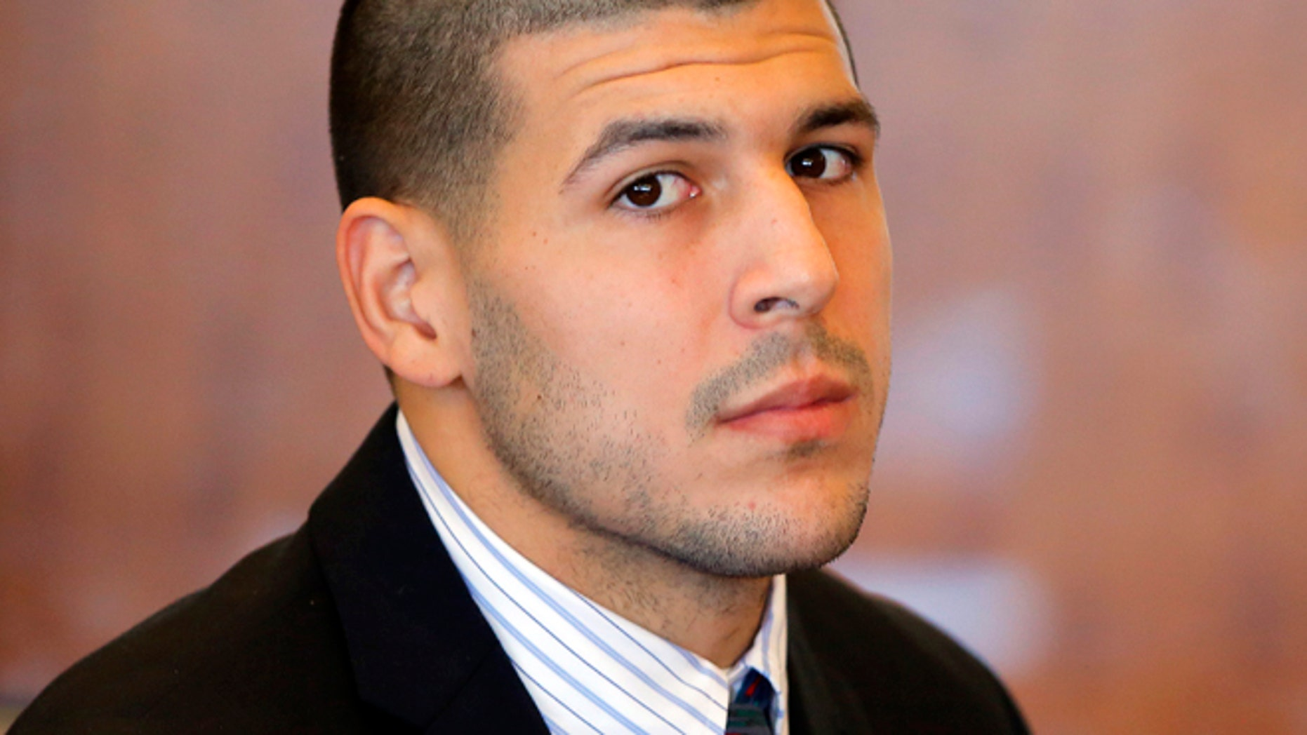 FILE 2013: Former New England Patriots NFL football player Aaron Hernandez attends a pretrial court hearing in Fall River, Mass. Hernandez is set to be arraigned on murder charges for allegedly ambushing and gunning down two men in 2012 after a chance encounter inside a Boston nightclub.