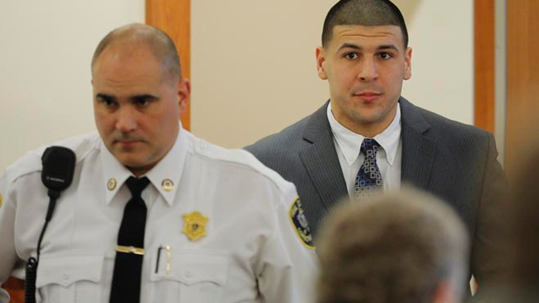 JUNE 2013: Former New England Patriots football player Aaron Hernandez arrives in the courtroom at Bristol County Superior Court in Fall River, Massachusetts.