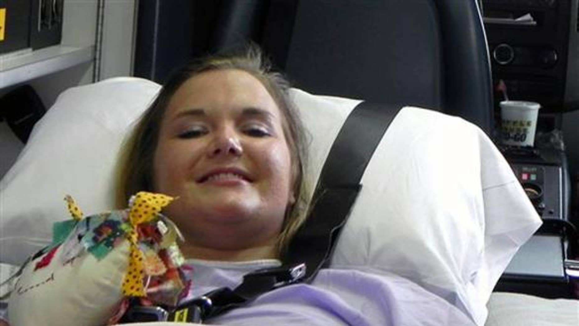 Aimee Copeland smiles as she leaves a hospital in Augusta Ga., July 2, headed for an inpatient rehabilitation clinic.