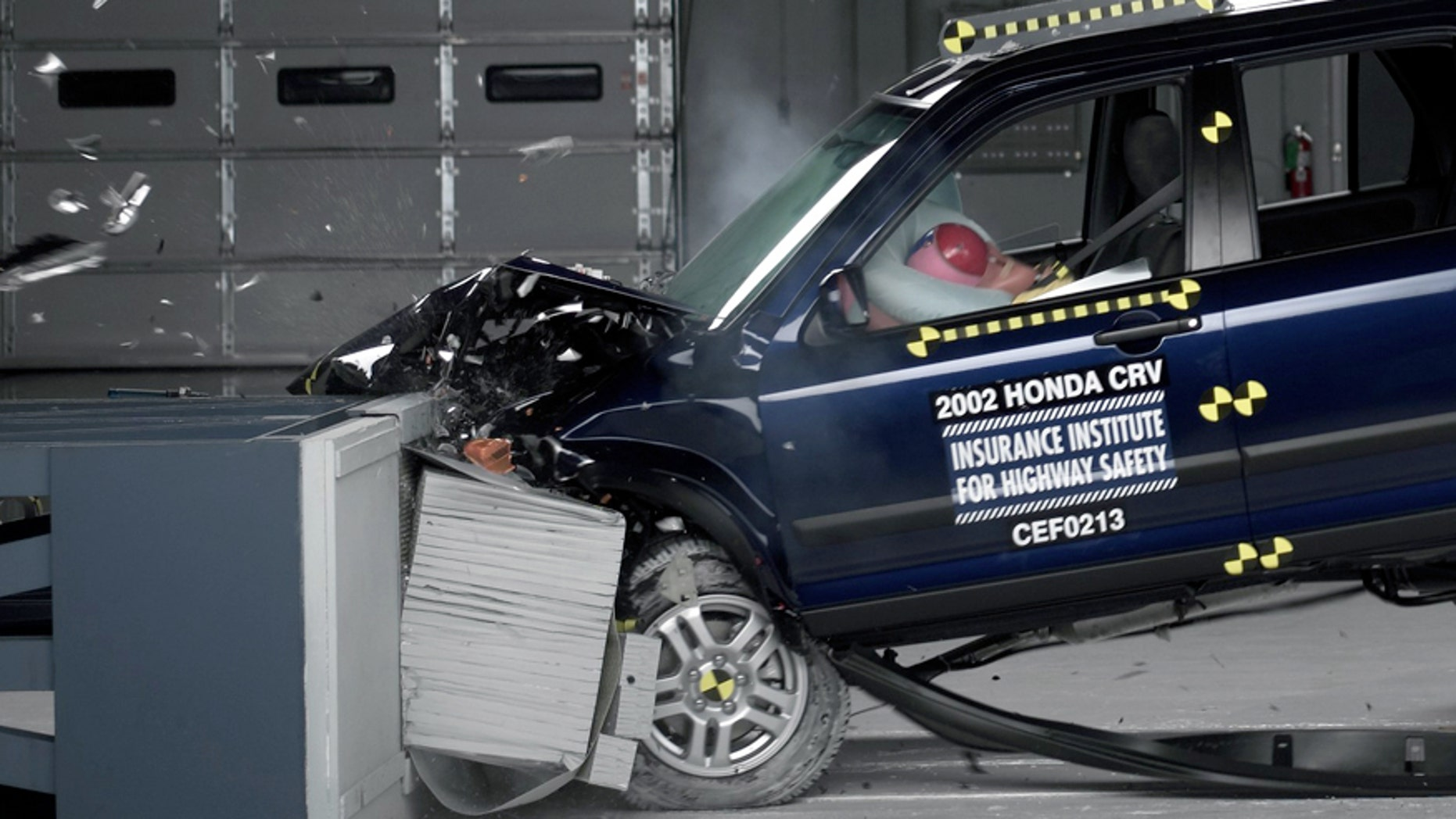 This undated photo provided by the Insurance Institute for Highway Safety shows a crash test of a 2002 Honda CR-V, one of the models subject to a recall to repair faulty air bags. In a letter delivered Thursday, Oct. 23, 2014, U.S. Senators Richard Blumenthal, D-Conn., and Ed Markey, D-Mass., are calling on regulators to issue a nationwide recall of cars with faulty air bags made by Takata Corp., questioning why automakers have been allowed to limit recalls to only certain locations with high humidity. (AP Photo/Insurance Institute for Highway Safety)