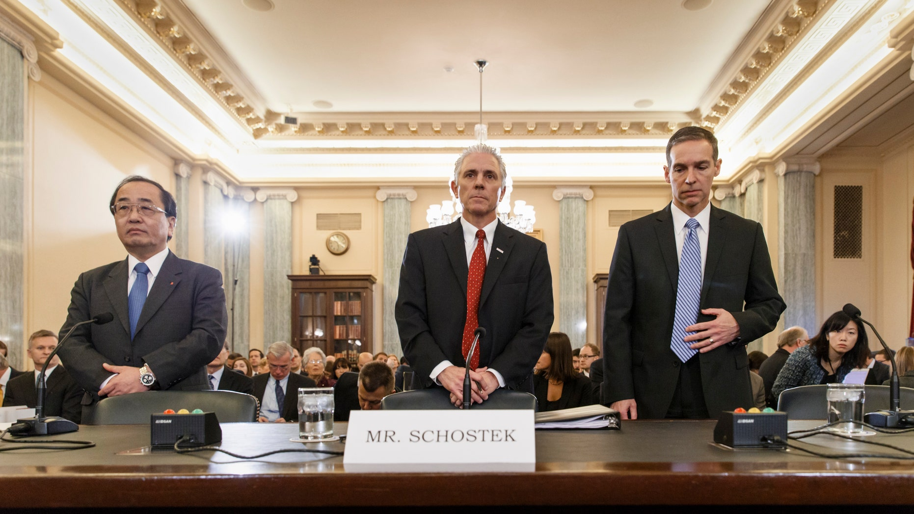 From left, Hiroshi Shimizu, senior vice president of global quality assurance at Japanese airbag maker Takata, Rick Schostek, executive vice president of Honda North America, and Scott Kunselman, Chrysler's senior vice president of vehicle safety and regulatory compliance, take their seats on Capitol Hill in Washington, Thursday, Nov. 20, 2014, prior to testifying before the Senate Commerce Committee hearing on airbags linked to multiple deaths and injuries in cars driven in the US. (AP Photo/J. Scott Applewhite)