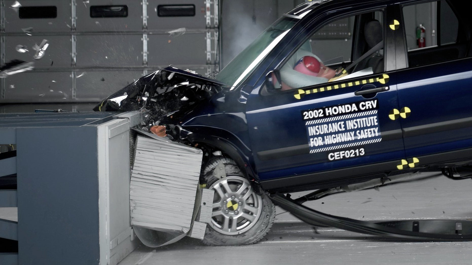 This undated photo provided by the Insurance Institute for Highway Safety shows a crash test of a 2002 Honda CR-V, one of the models subject to a recall to repair faulty air bags.  The federal government is demanding that the auto industry recall millions of additional cars equipped with faulty air bags that can injure  and even kill  a driver. (AP Photo/Insurance Institute for Highway Safety)