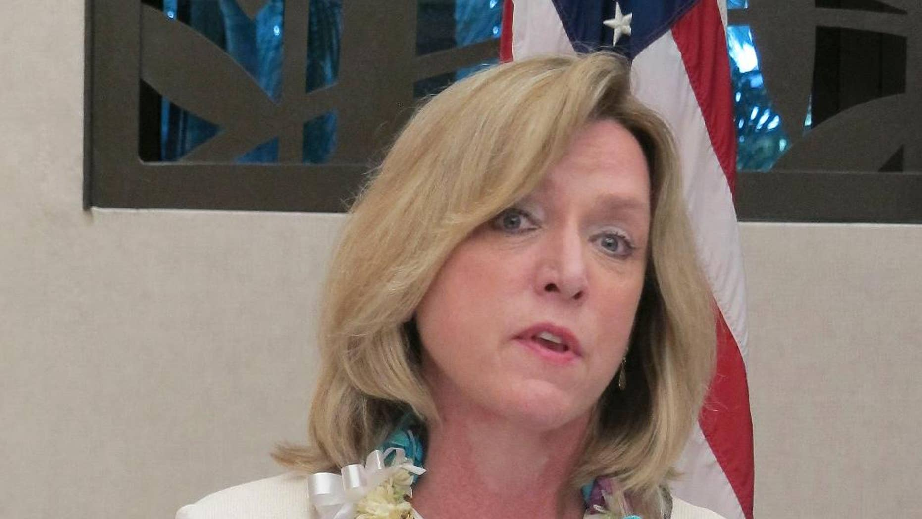 Air Force Secretary Deborah Lee James speaks to reporters at Joint Base Pearl Harbor-Hickam in Hawaii on Monday, Nov. 17, 2014. James said she hopes to make all jobs in the service open to qualified women in the next year and a half. (AP Photo/Audrey McAvoy)