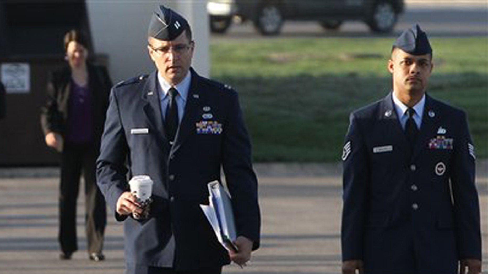 July 20, 2012 Air Force Staff Sgt. Luis Walker, right,  arrived for the fourth day of his trial at Lackland Air Force Base in San Antonio, Texas.