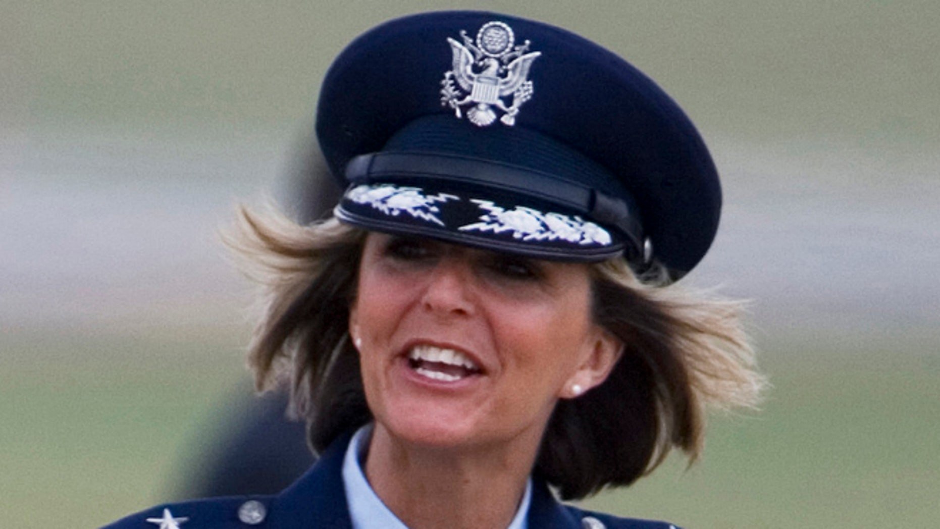 Aug. 4, 2008: In this file photo, Brig. Gen. Margaret Woodward, the 389th Airlift Wing Commander, waves on the tarmac of Andrews Air Force Base in Maryland.