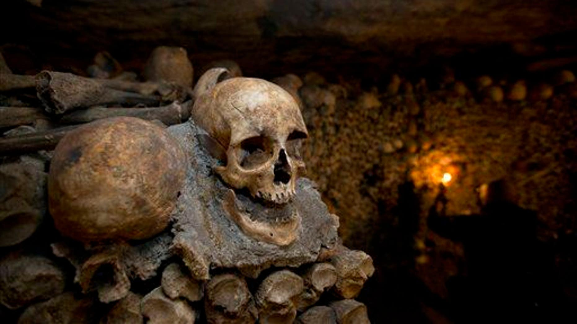 Skulls and bones are stacked at the Catacombs in Paris.