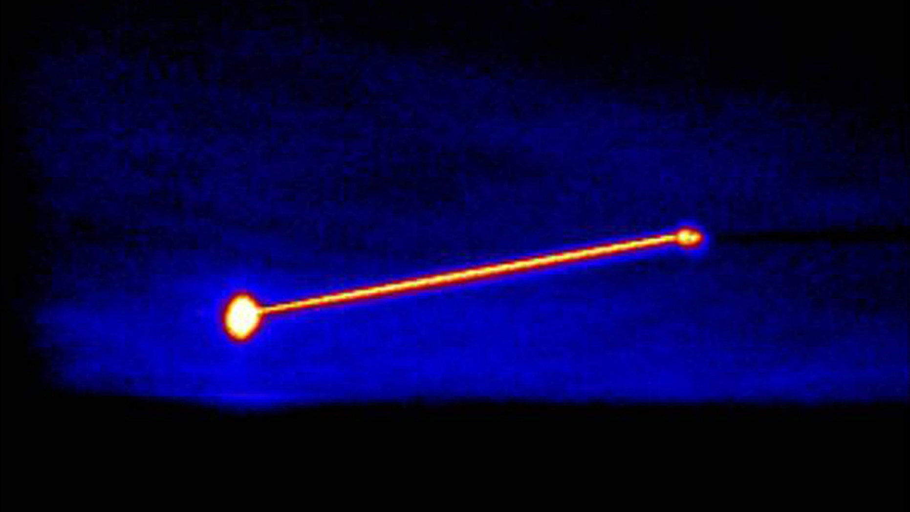 An infrared image of the Missile Defense Agency's Airborne Laser Testbed (right) destroying a threat representative short-range ballistic missile (left).