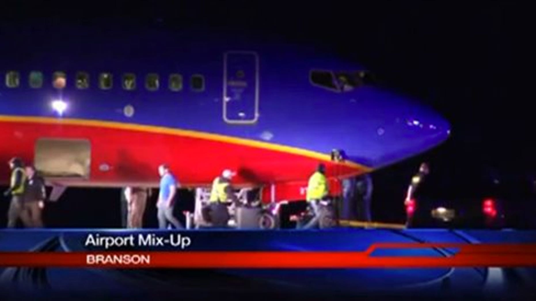 This frame grab provided by KSPR-TV shows a Southwest Airlines flight that was scheduled to arrive Sunday Jan. 12, 2014, at Branson Airport in southwest Missouri instead landed at an airport 7 miles north  with a runway about half the size of the intended destination. (AP Photo/KSPR-TV)