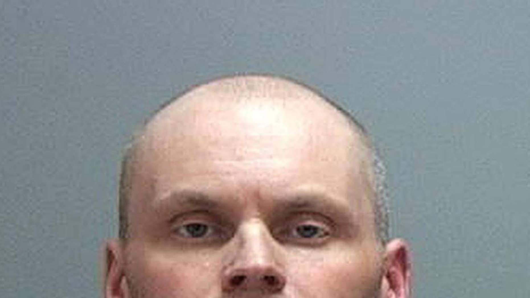 This Monday, April 27, 2015 booking photo provided by the Salt Lake County Sheriff shows Leo Greene, 39, of Salt Lake City. Greene has been arrested after crashing through a fence and sprinting from police onto a runway at the Salt Lake City airport early Monday, April 27, 2015. The 8-minute chase started on a public road near Salt Lake City International when an airport police officer tried to stop a car with its bumper dragging. The car took off, crashing through the fence lines and onto the tarmac area. The car then crashed into another fence and Greene jumped out and ran before being arrested. (Salt Lake County Sheriff via AP)