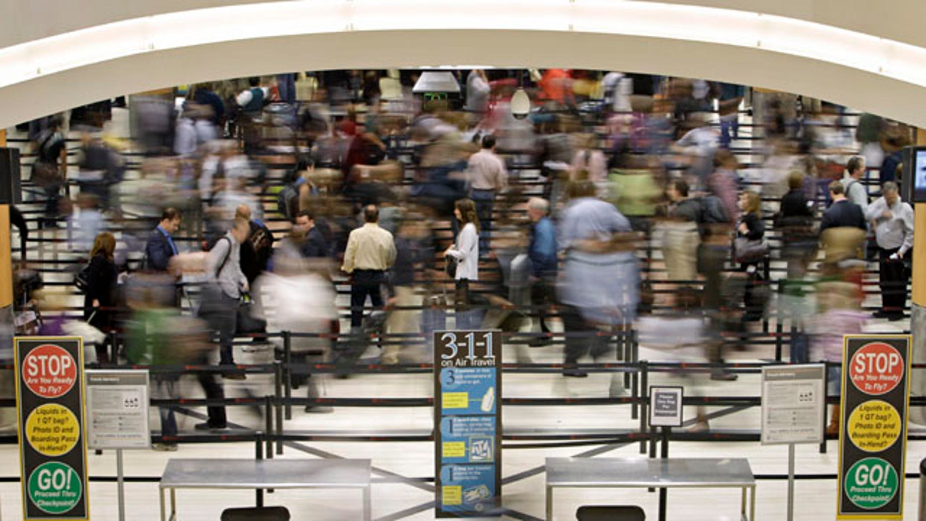 Nov. 18: Passengers move through the line at a security checkpoint at Hartsfield-Jackson Atlanta International Airport in Atlanta. Experts say the TSA faces an all but impossible task: stand as the last line against unknown terror without treating everyone as a potential terrorist.