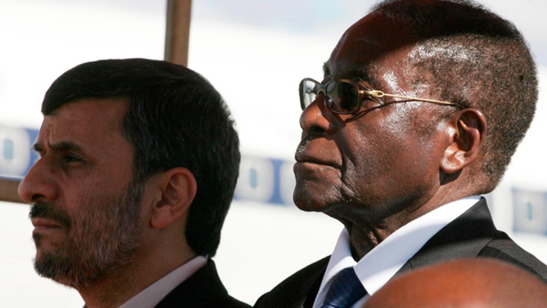 April 22: Robert Mugabe and Mahmoud Ahmadinejad pictured together at Harare Airport.