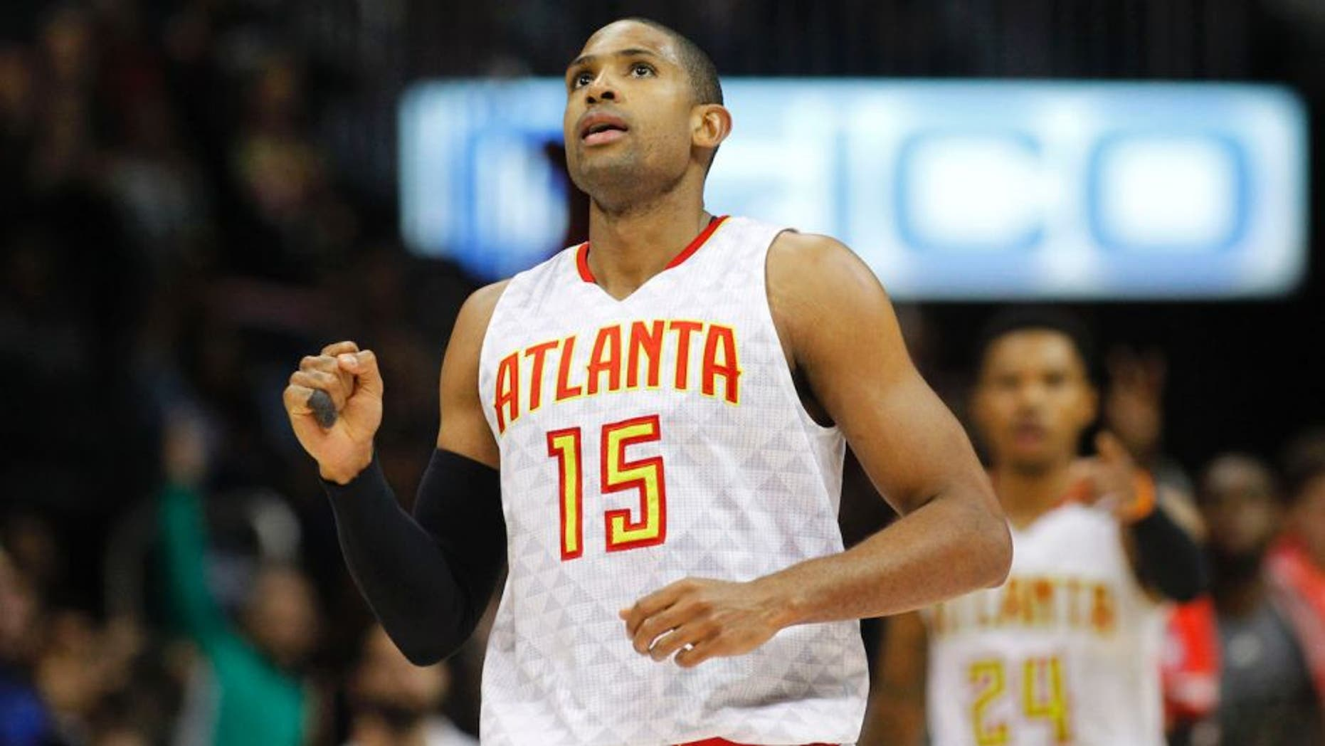 Feb 5, 2016; Atlanta, GA, USA; Atlanta Hawks center Al Horford (15) shows emotion after a made shot against the Indiana Pacers in the fourth quarter at Philips Arena. The Hawks defeated the Pacers 102-96. Mandatory Credit: Brett Davis-USA TODAY Sports