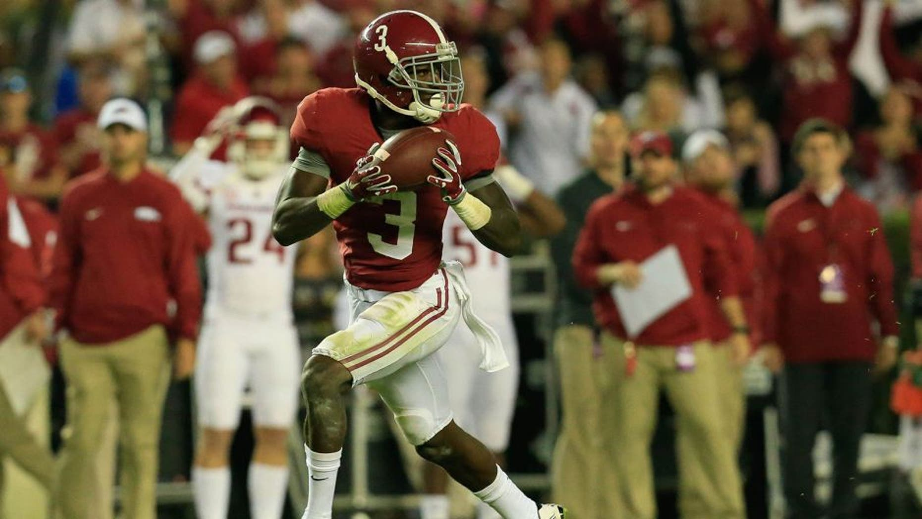 Oct 10, 2015; Tuscaloosa, AL, USA; Alabama Crimson Tide wide receiver Calvin Ridley (3) catches a touchdown pass against the Arkansas Razorbacks at Bryant-Denny Stadium. Mandatory Credit: Marvin Gentry-USA TODAY Sports