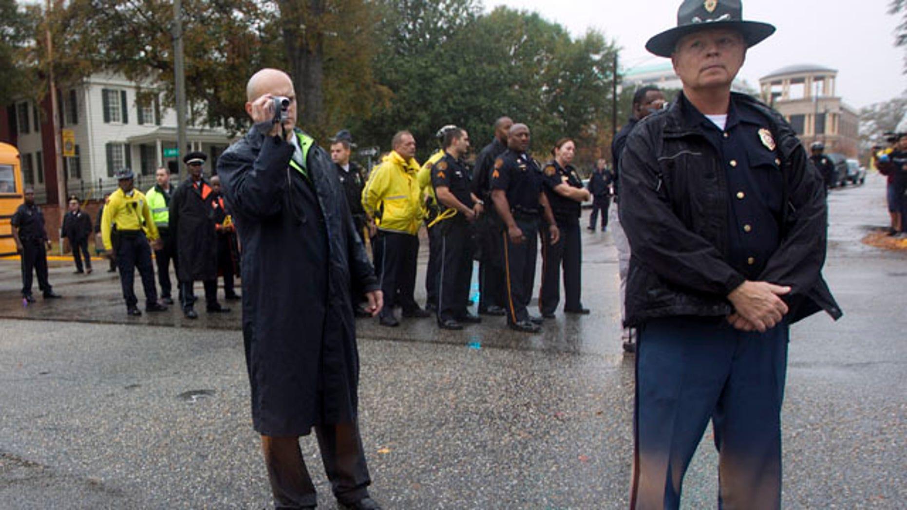 File photo, November 1, 2011. State police prepare to make arrests in protest against Alabama's hardline immigration law. (AP/Dave Martin)