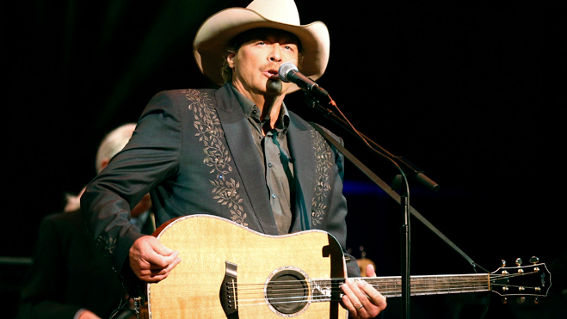 """Singer Alan Jackson performs during """"A Concert for Hope"""" at the Kennedy Center in Washington September 11, 2011 on the 10th anniversary of the 9/11 attacks."""