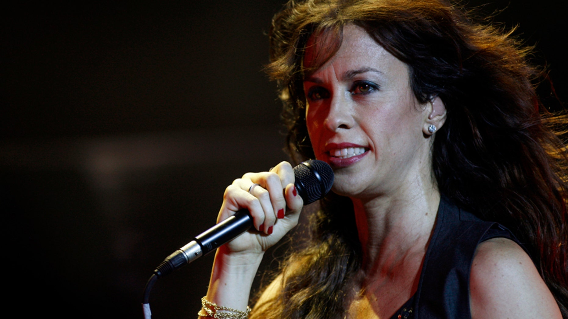 Canadian musician Alanis Morissette performs during a concert.