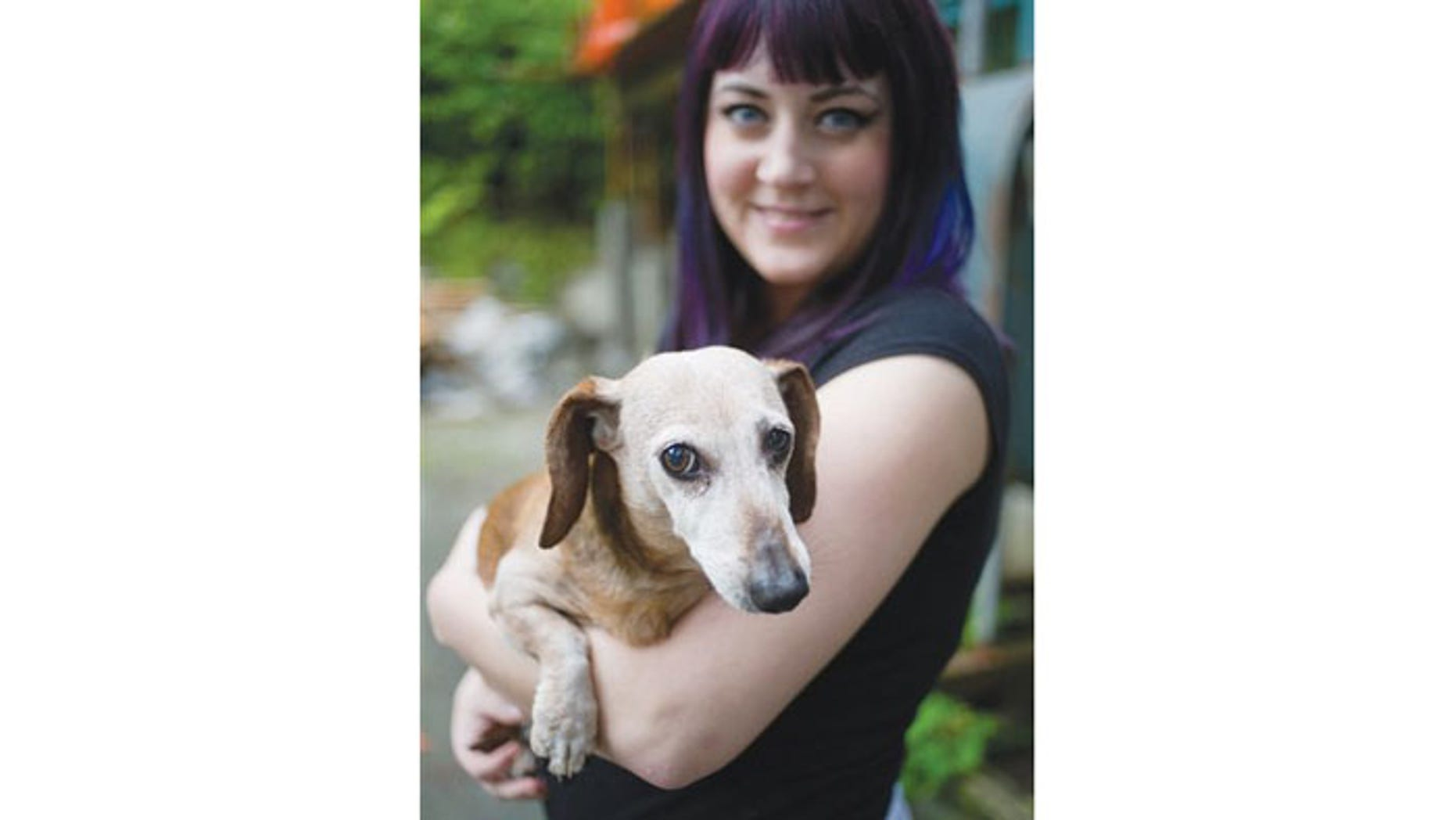 August 30: Brook Collins holds her dog, Fudge, at her home in Juneau, Alaska.