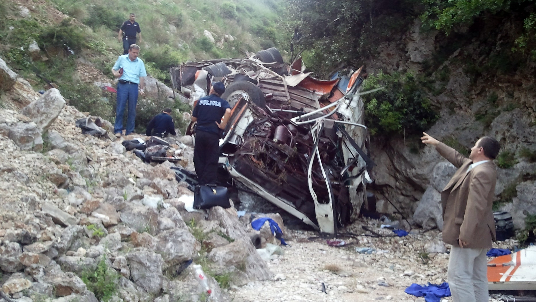 May 21: Rescue personnel attend the scene of a bus accident  as the bus lies at the bottom of a cliff near Himare southern Albania. The bus had been heading from the city of Elbasan to the southern city of Saranda. Police spokeswoman Klejda Plangarica said the bus fell some 80 meters (yards) off the road in Qafa e Vishes near the town of Himare, 137 miles (220 kilometers) south of the capital, Tirana, on Monday afternoon.
