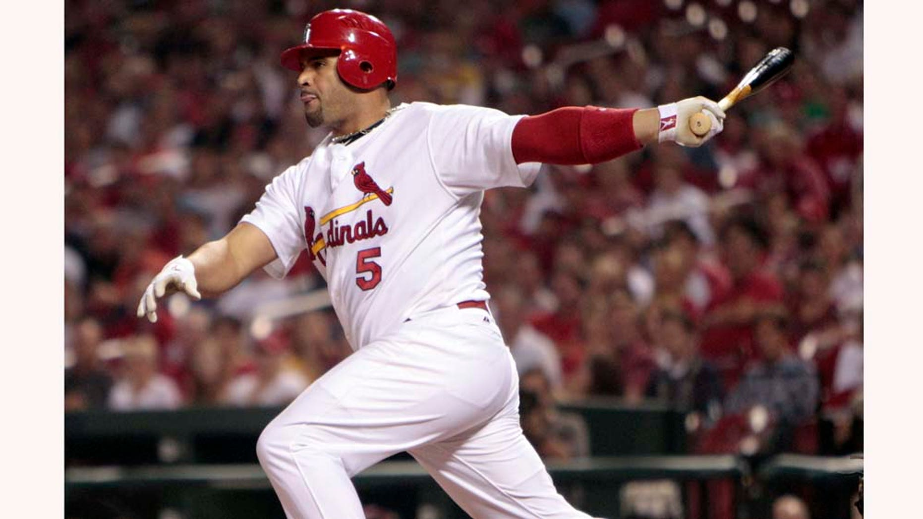 FILE - This Sept. 17, 2010, file photo shows St. Louis Cardinals' Albert Pujols hitting an RBI-double during the first inning of a baseball game against the San Diego Padres, in St. Louis. Pujols is seeking a deal that would make him one of baseball's highest-paid players.  (AP Photo/Jeff Roberson, File)