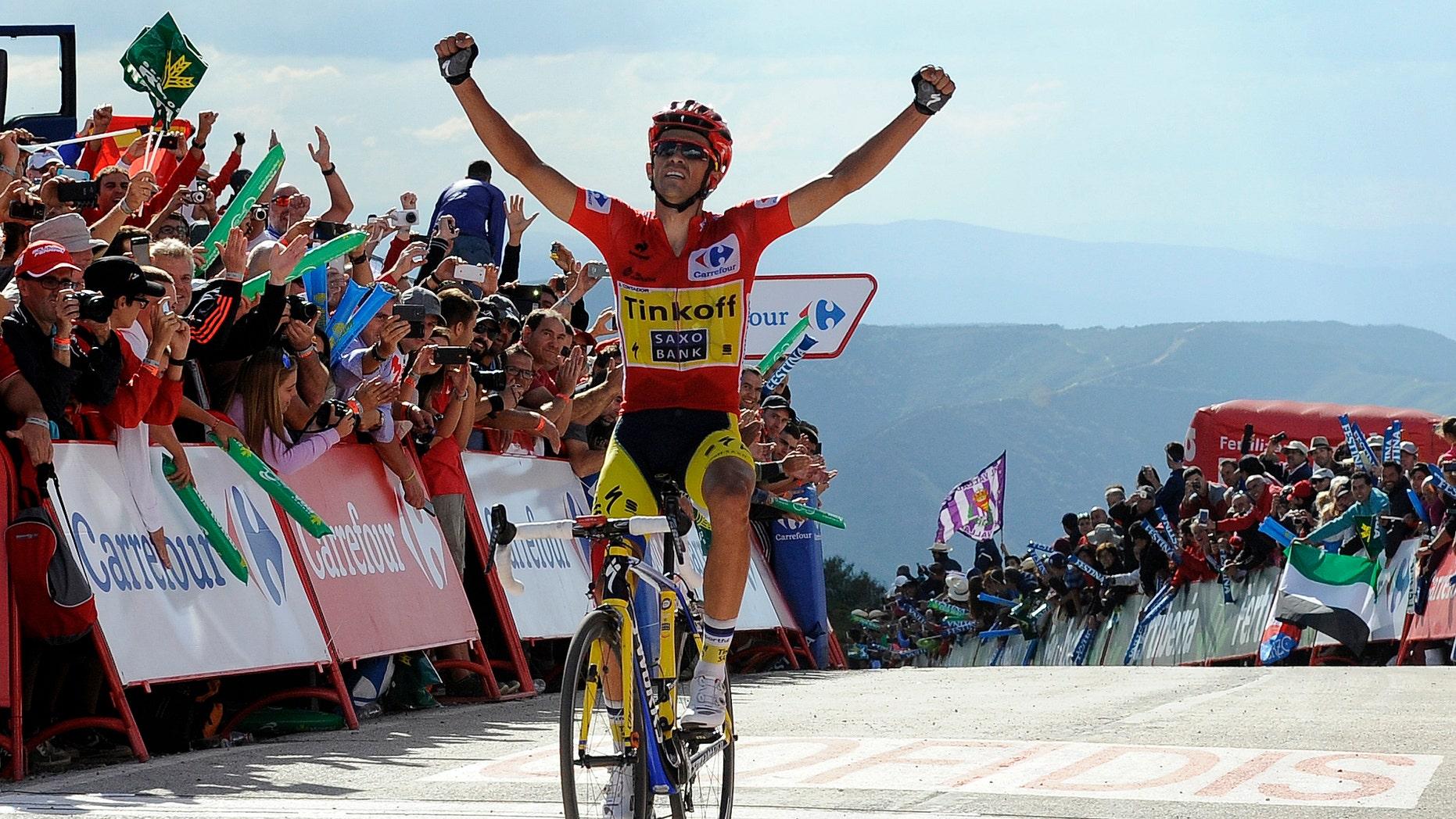 Alberto Contador of Spain wins the 20th stage of the Spanish Vuelta cycling, a 185.7-kilometer (115-mile) ride between Santo Estevo De Ribas De Sil and Puerto De Ancares, Spain, Saturday, Sept. 13, 2014. Contador won the 20th stage of the Spanish Vuelta Saturday and consolidated his leadership. The 21-stage race ends tomorrow, Sept. 14, in Santiago de Compostela. (AP Photo/Paulo Duarte)