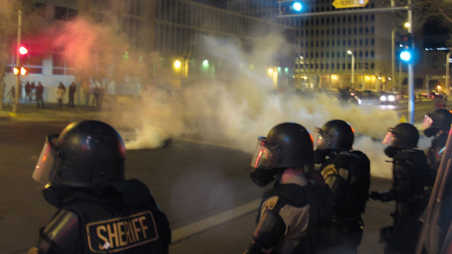 Riot police launch tear gas in downtown Albuquerque, N.M. following a 10-hour protest around the city, March 30, 2014.