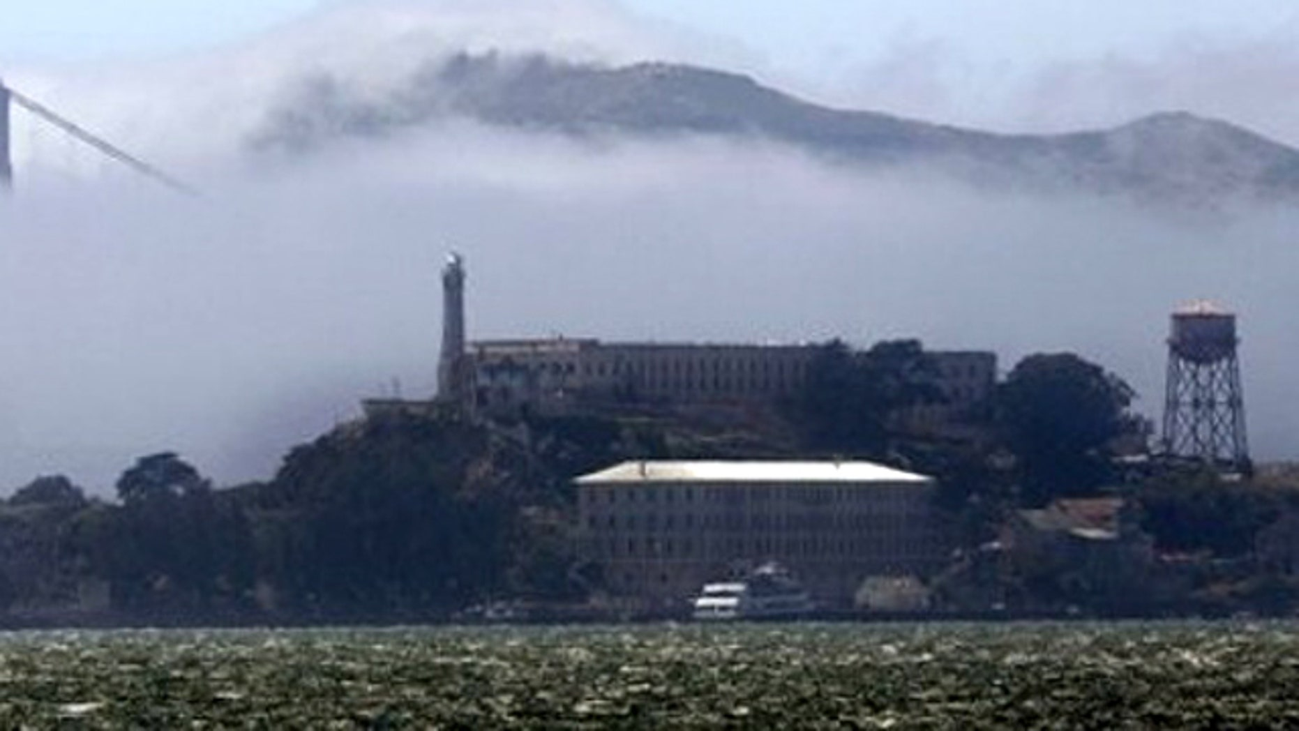 Alcatraz Island and a span of the Golden Gate Bridge are shown from Treasure Island, Calif., Monday, July 4, 2011.