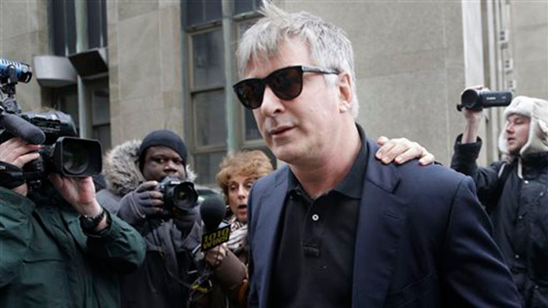 In this Tuesday, Nov. 12, 2013 file photo,  actor Alec Baldwin leaves criminal court in New York.