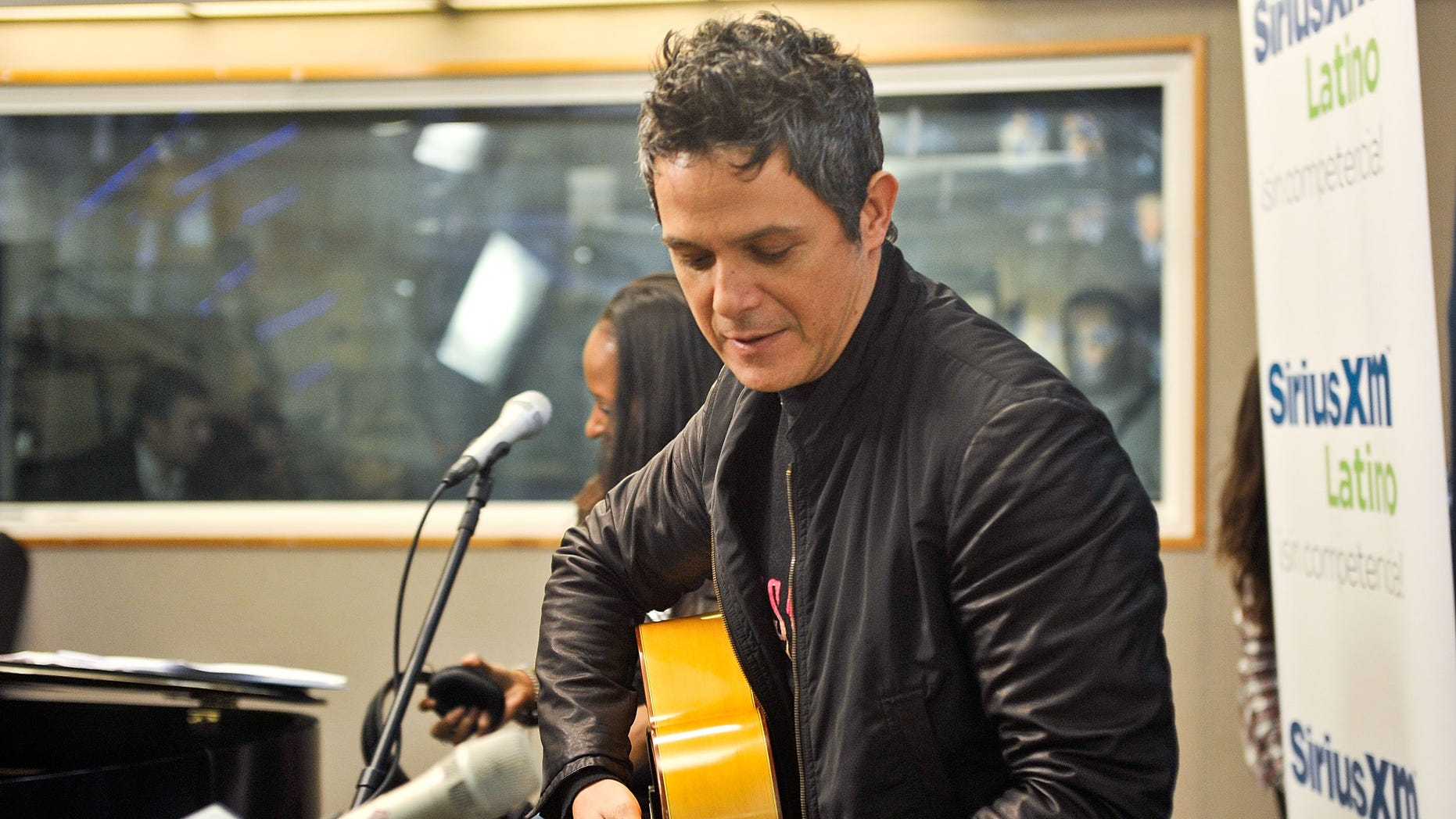 """NEW YORK, NY - MAY 03:  Spanish singer/songwriter Alejandro Sanz visits the SiriusXM studios for """"SiriusXM's ICONOS"""" on May 3, 2013 in New York City. (Photo by Daniel Zuchnik/Getty Images)"""