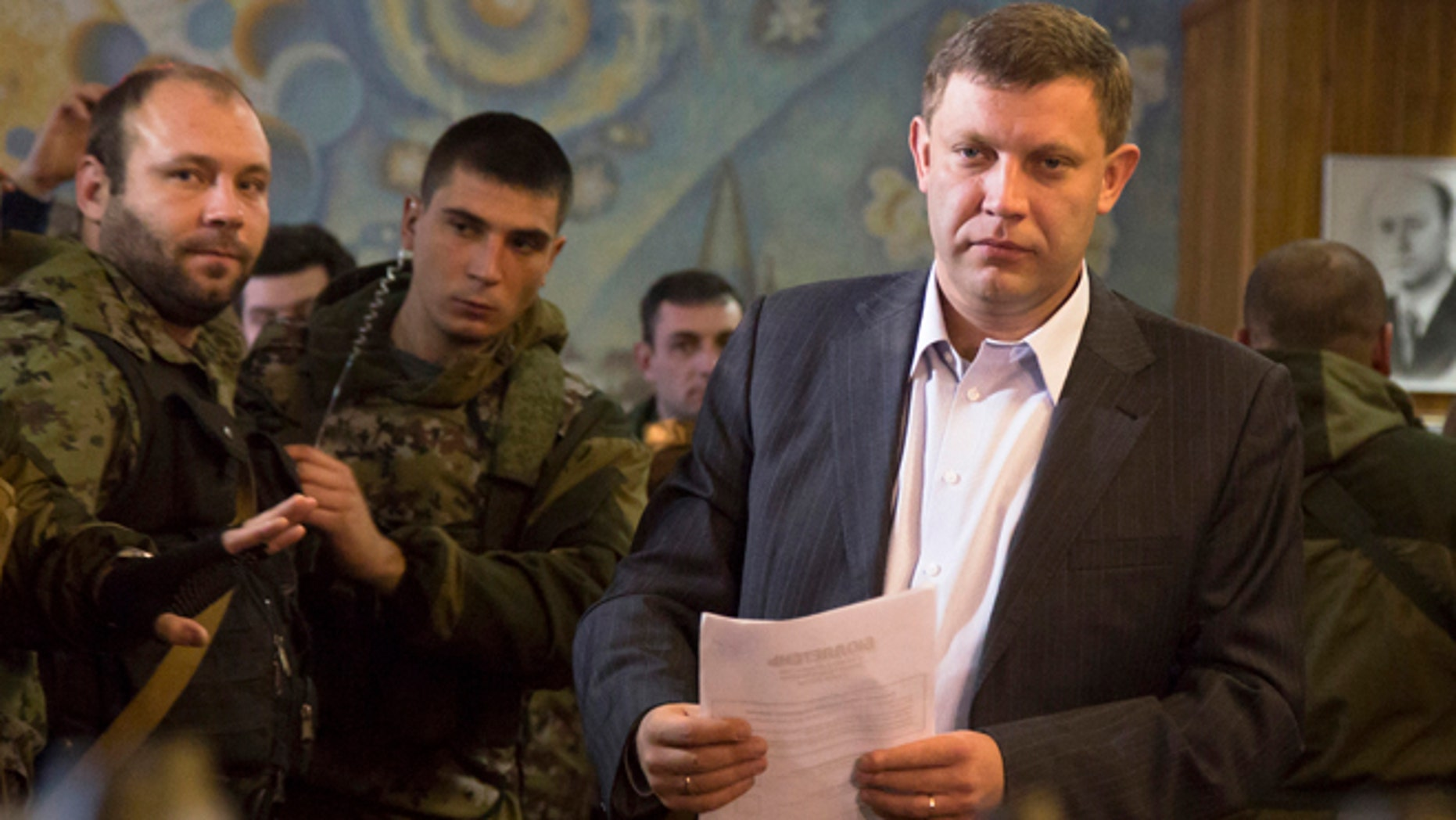 Nov. 2, 2014: Pro-Russian rebel leader Alexander Zakharchenko prepares to casts his ballot during supreme council and presidential elections in the city of Donetsk, eastern Ukraine.