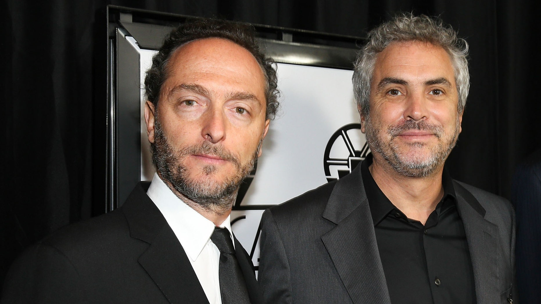 CENTURY CITY, CA - JANUARY 11:  (L-R) Cinematographer Emmanuel Lubezki, and director Alfonso Cuaron, attend the 39th Annual Los Angeles Film Critics Association Awards at InterContinental Hotel on January 11, 2014 in Century City, California.  (Photo by Imeh Akpanudosen/Getty Images)