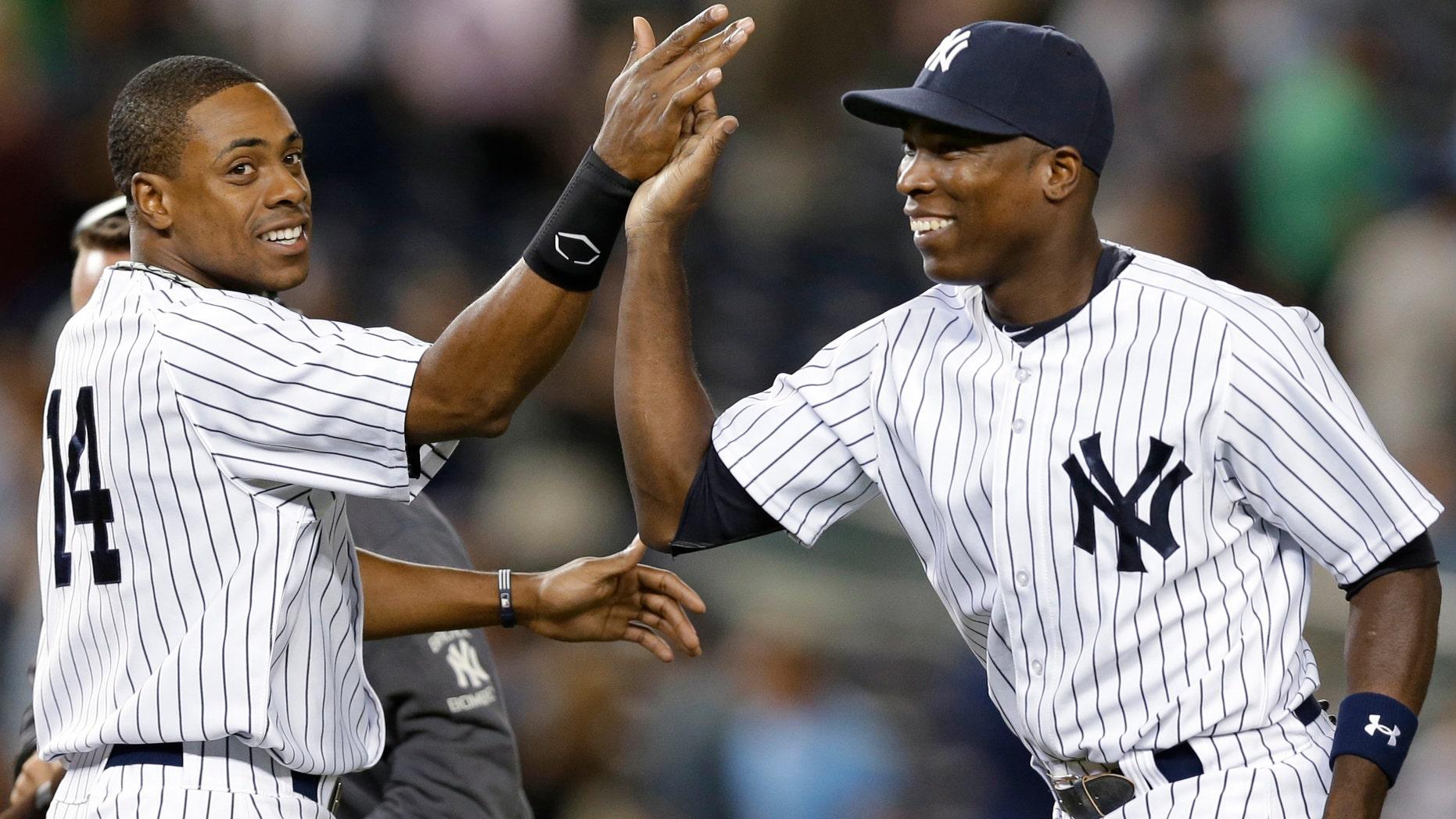 New York Yankees right fielder Curtis Granderson, left, congratulates left fielder Alfonso Soriano. (AP Photo/Kathy Willens)