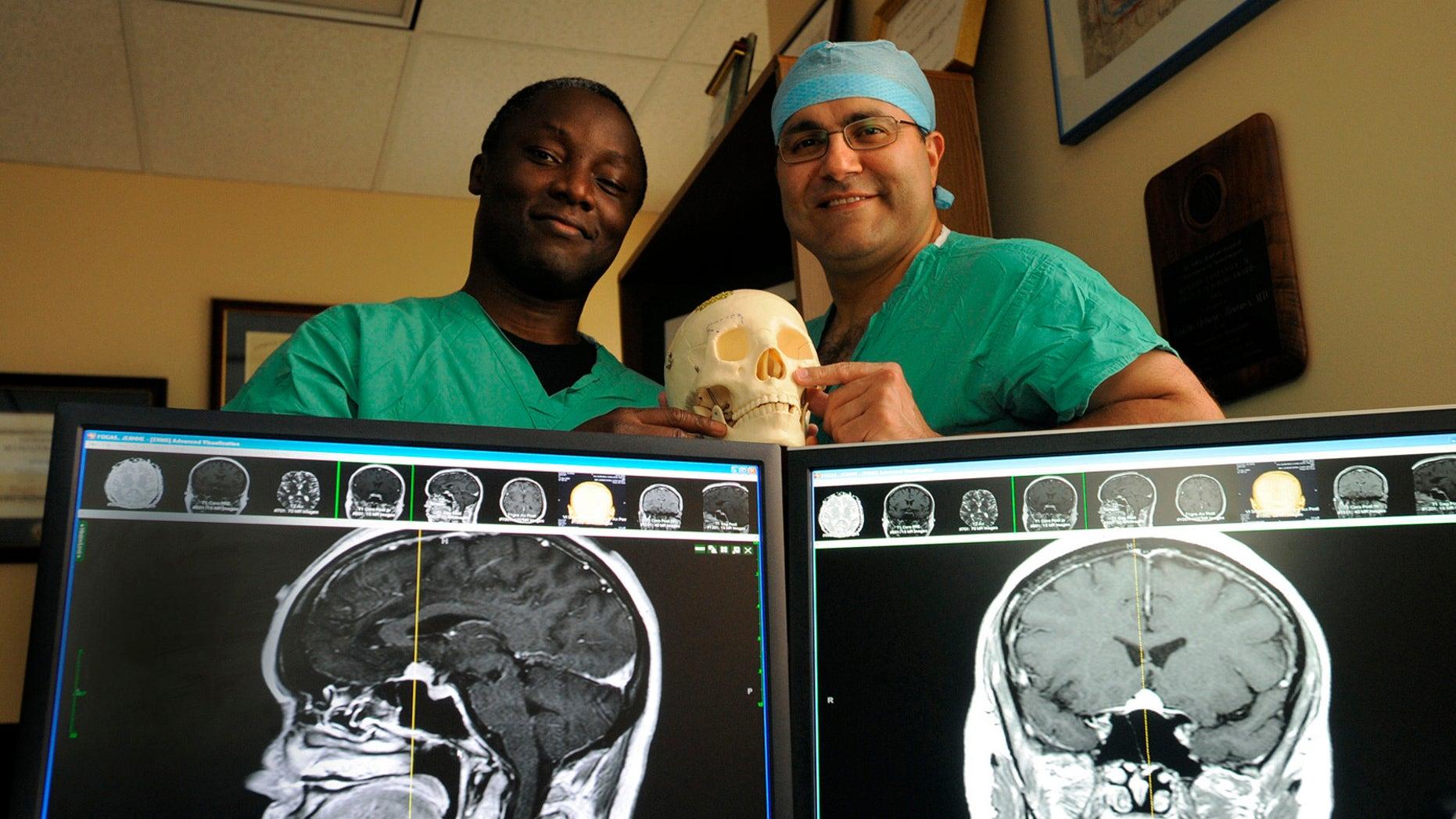 Kofi Boahene, M.D., left, and Alfredo Quinones-Hinojosa, M.D. in a 2010 file photo.