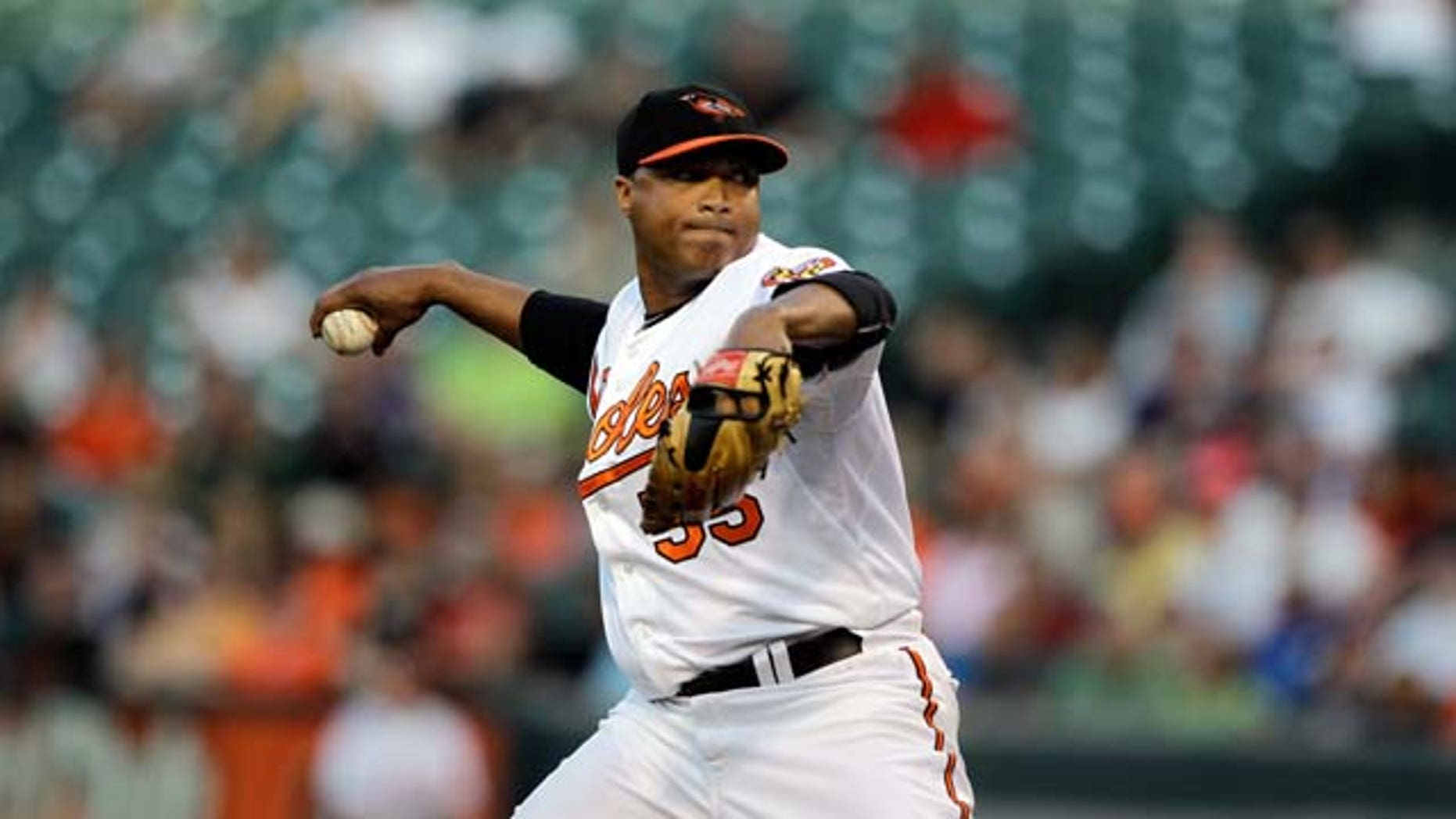 BALTIMORE, MD - JULY 16:  Starting pitcher Alfredo Simon #55 of the Baltimore Orioles delivers to a Cleveland Indians batter at Oriole Park at Camden Yards on July 16, 2011 in Baltimore, Maryland.  (Photo by Rob Carr/Getty Images)