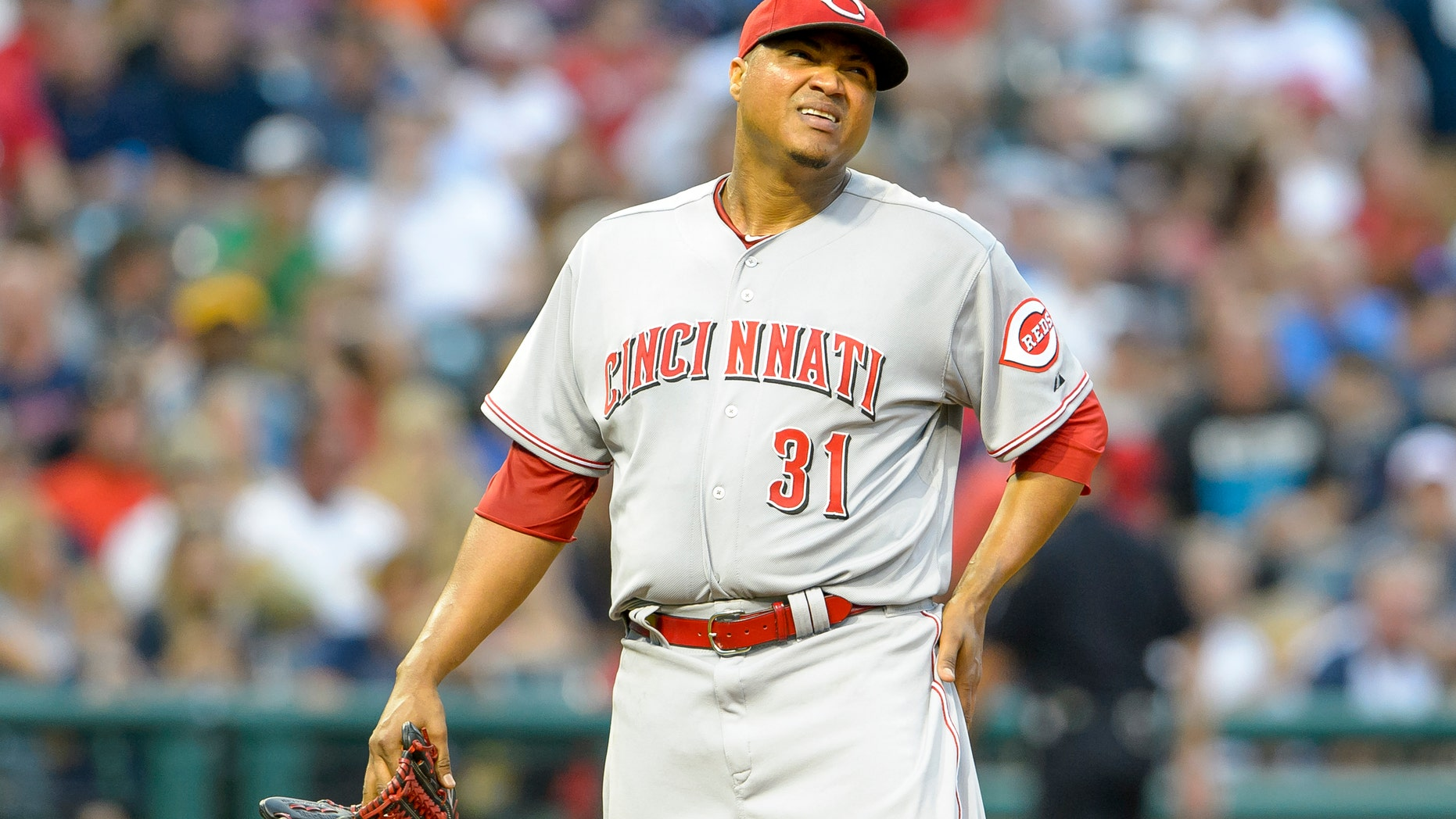 CANTON, OH - AUGUST 4: Starting pitcher Alfredo Simon #31 of the Cincinnati Reds reacts after giving up a three-run home run during the fourth inning against the Cleveland Indians at Progressive Field on August 4, 2014 in Cleveland, Ohio. (Photo by Jason Miller/Getty Images)