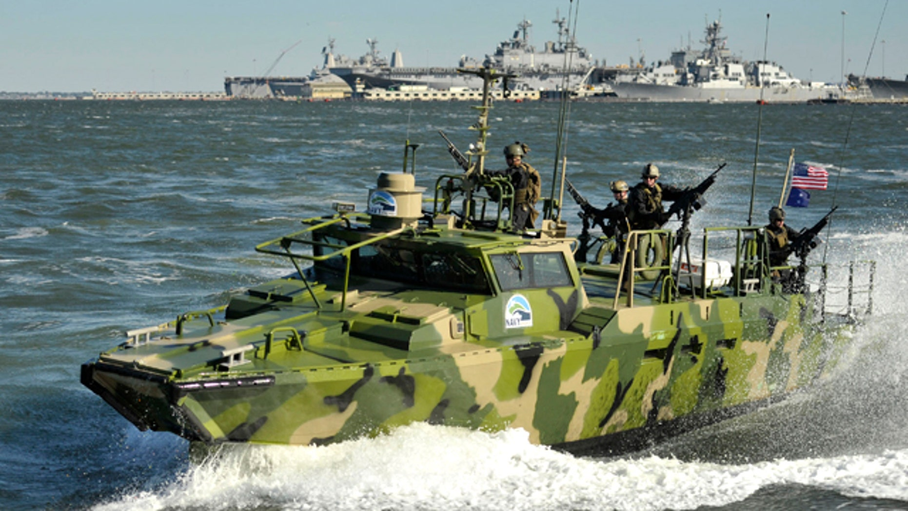 Sailors assigned to Riverine Group 1 conduct maneuvers aboard Riverine Command Boat (Experimental) (RCB-X) at Naval Station Norfolk, Va. on Oct. 22, 2010. The RCB-X is powered by an alternative fuel blend that's 50 percent algal and 50 percent NATO F-76 fuel, reducing the total energy consumption on naval ships.
