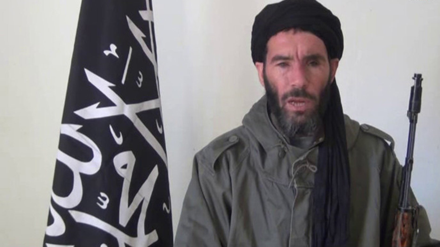 This image taken from video provided by the SITE Intel Group made available Thursday Jan. 17, 2013, purports to show militant militia leader Moktar Belmoktar.