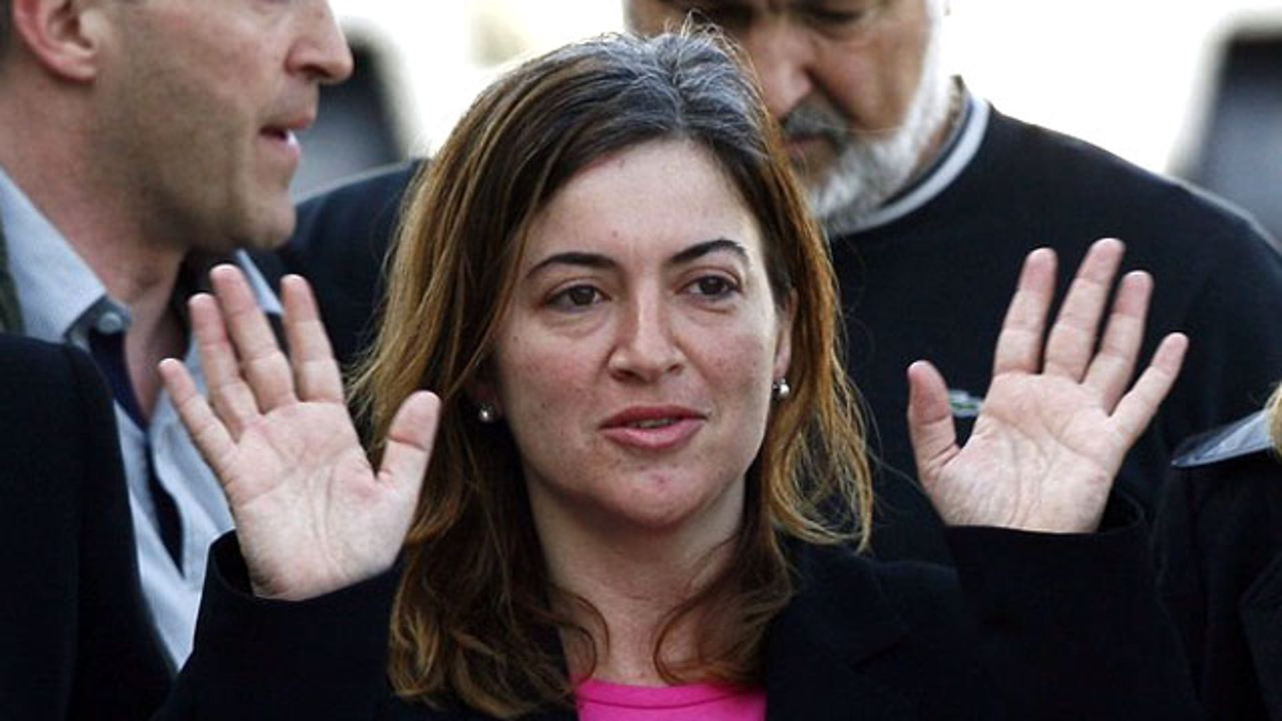 Alicia Gamez gestures during her arrival at Barcelona's airport March 10, 2010. Gamez, who was held hostage in Mali by a group believed to be al Qaeda's wing in North Africa, has been freed, the Spanish government said on Wednesday. Aid-worker Gamez was part of an aid convoy travelling to southern Senegal when she was seized in northern Mauritania in November along with two Spanish colleagues Albert Vilalta and Roque Pascual.