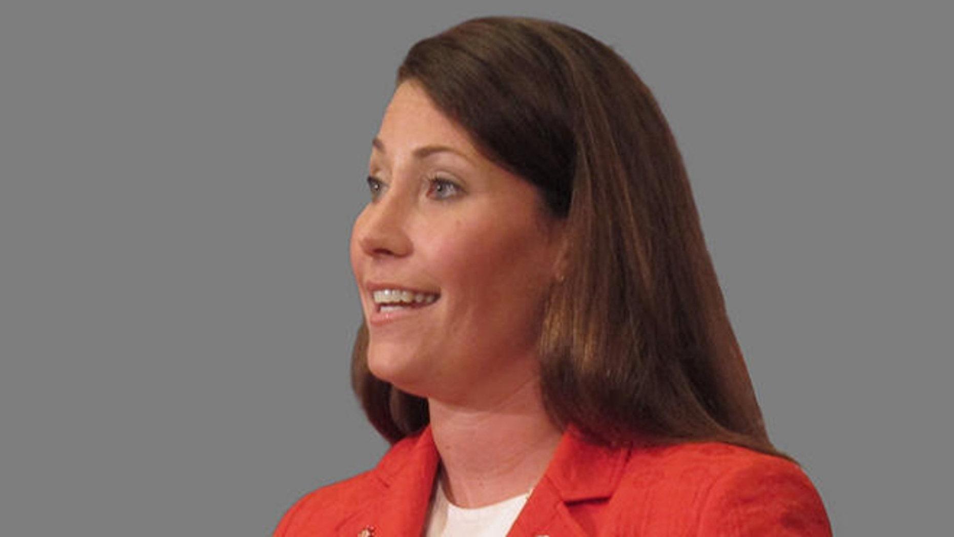 FILE: July 7, 2013: Alison Lundergan Grimes, a Democratic candidate for U.S. Senate, in Kentucky. (headshot.)