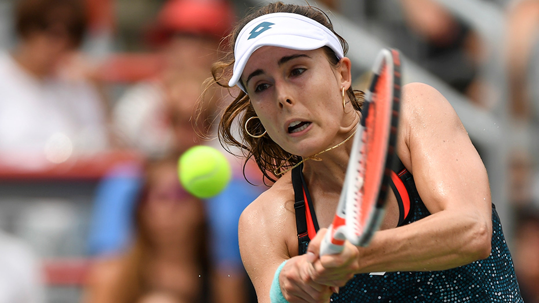The US Open was accused of sexism after Alizé Cornet was hit with a code violation after briefly rearranging her top during a match on Tuesday, August 28, 2018.