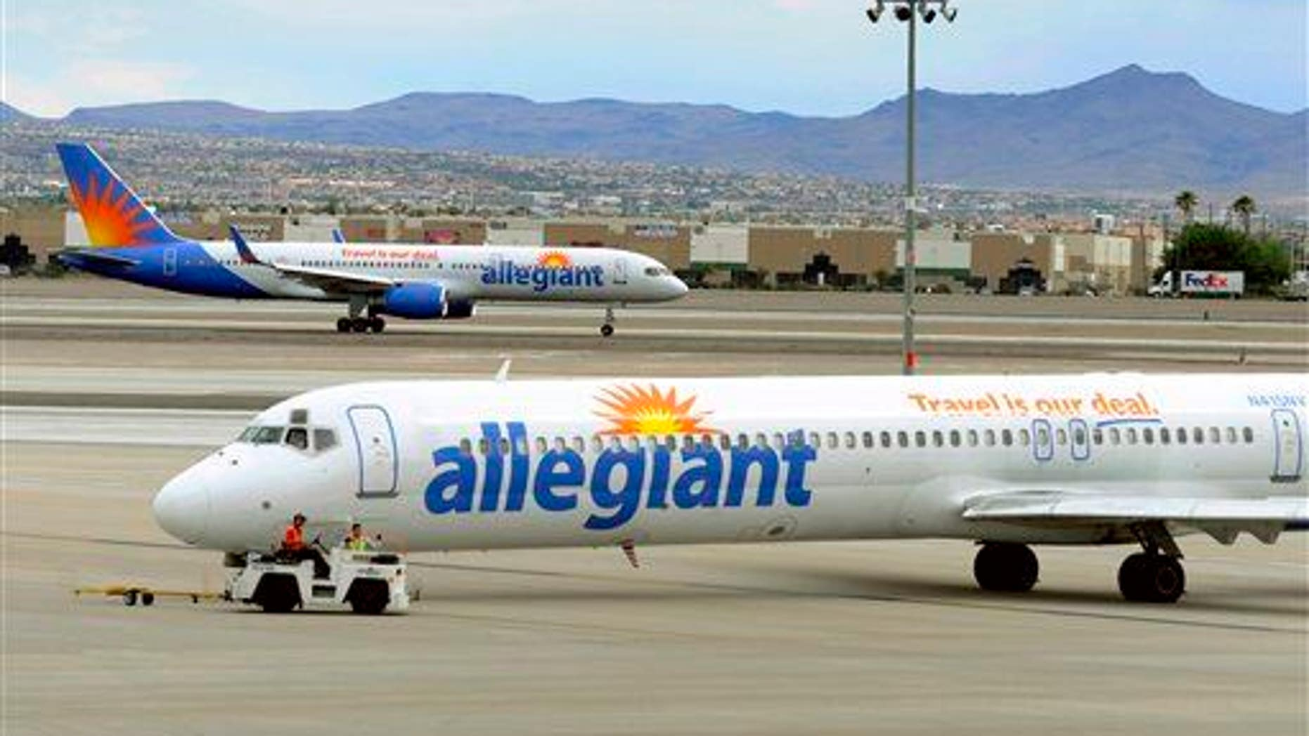 In this Thursday, May 9, 2013, file photo, two Allegiant Air jets taxi at McCarran International Airport in Las Vegas.