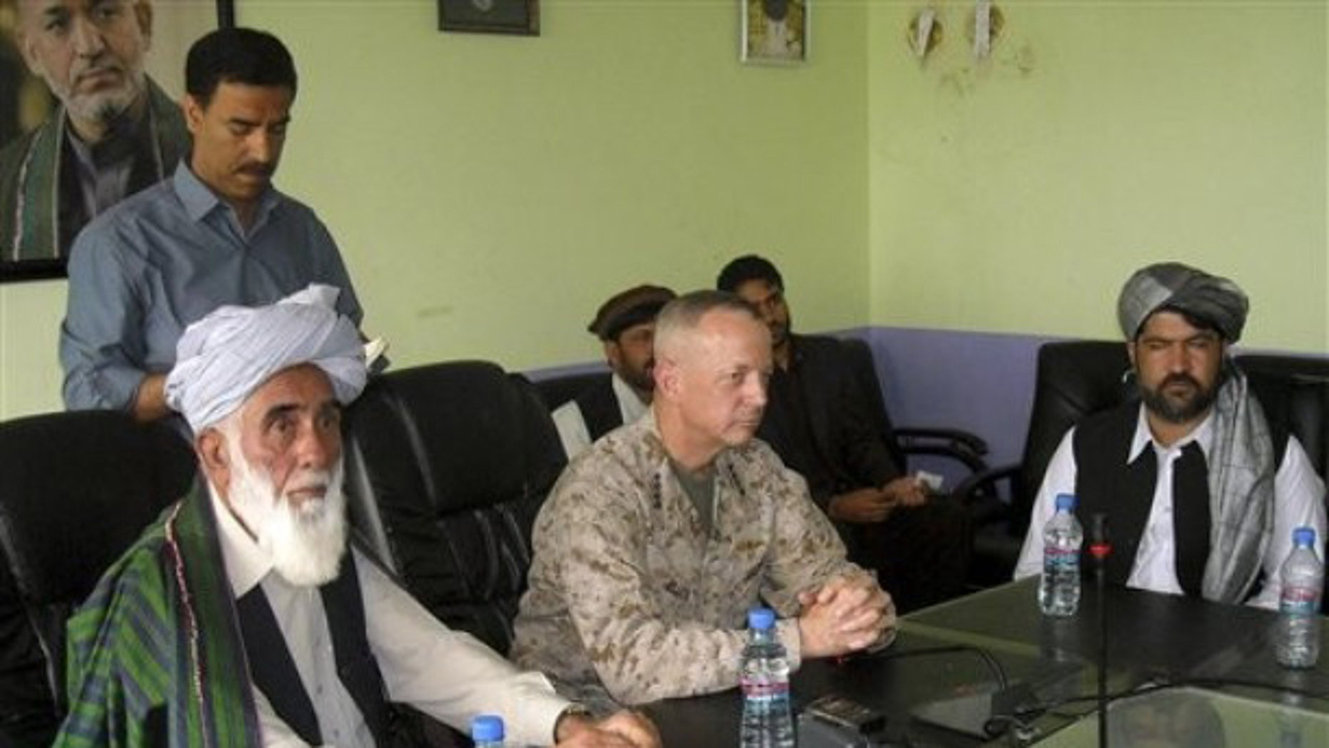 June, 8, 2012: The commander of US and NATO troops in Afghanistan, US Marine Lt. General John Allen, center, meets with the Governor of Logar Province, Allhaj Mohammad Tahir Sabari, left, south of Kabul, Afghanistan.