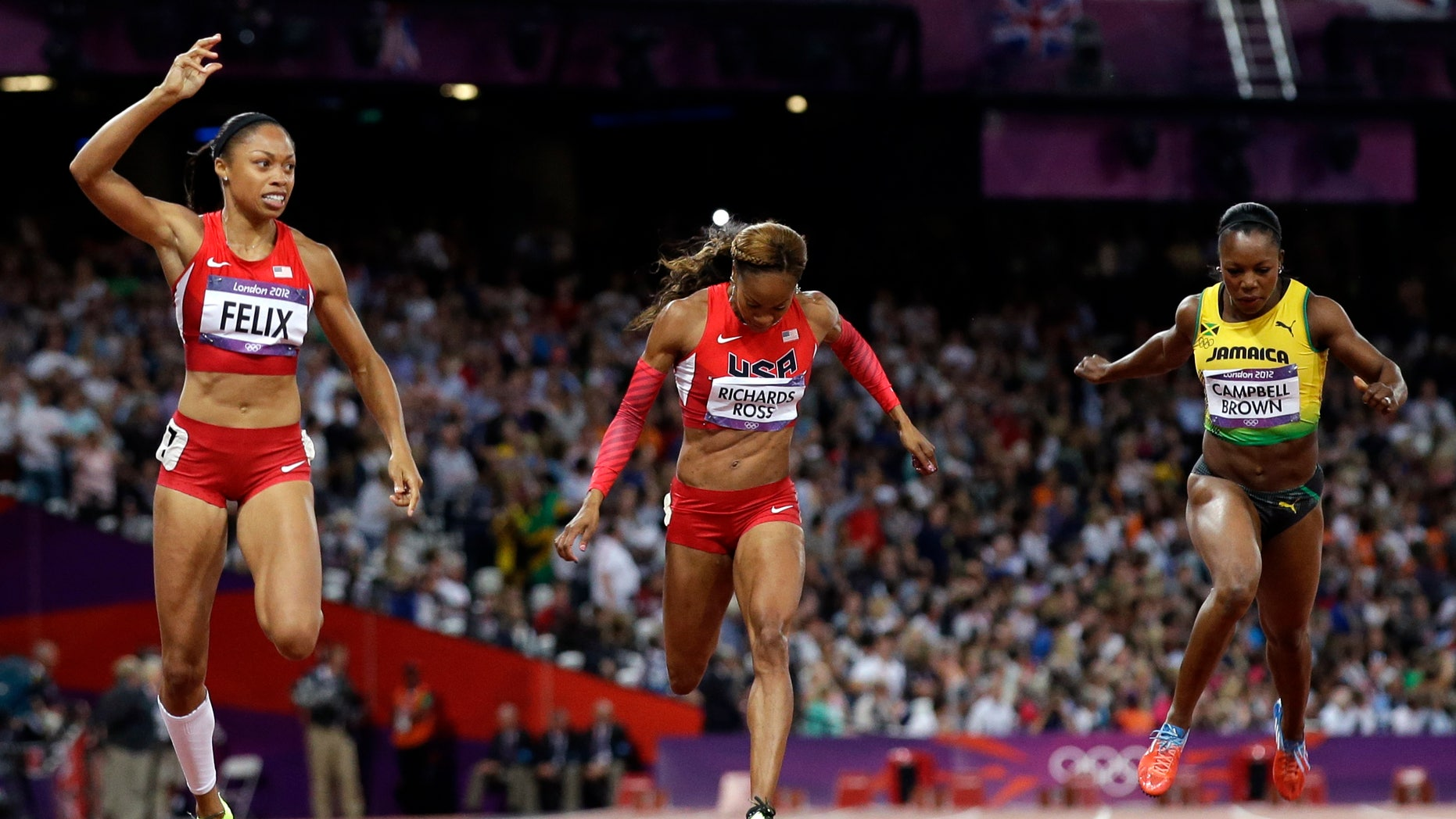 Aug. 8, 2012: United States' Allyson Felix leads teammate Sanya Richards-Ross and Jamaica's Veronica Campbell-Brown to win the women's 200-meter final during the athletics in the Olympic Stadium at the 2012 Summer Olympics, London.