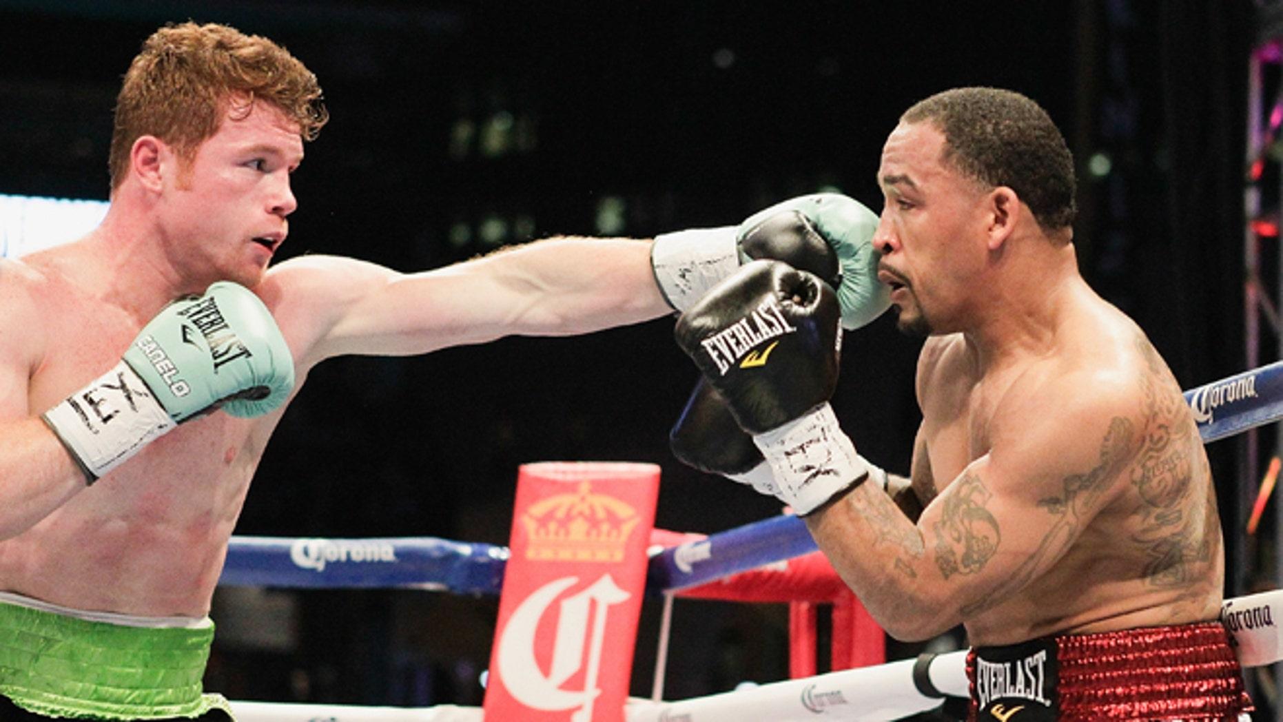 "Saul ""Canelo"" Alvarez, left, lands a a jab to the face of James Kirkland during a 154-pound fight on Saturday, May 9, 2015, in Houston. Alvarez won the bout. (AP Photo/Bob Levey)"
