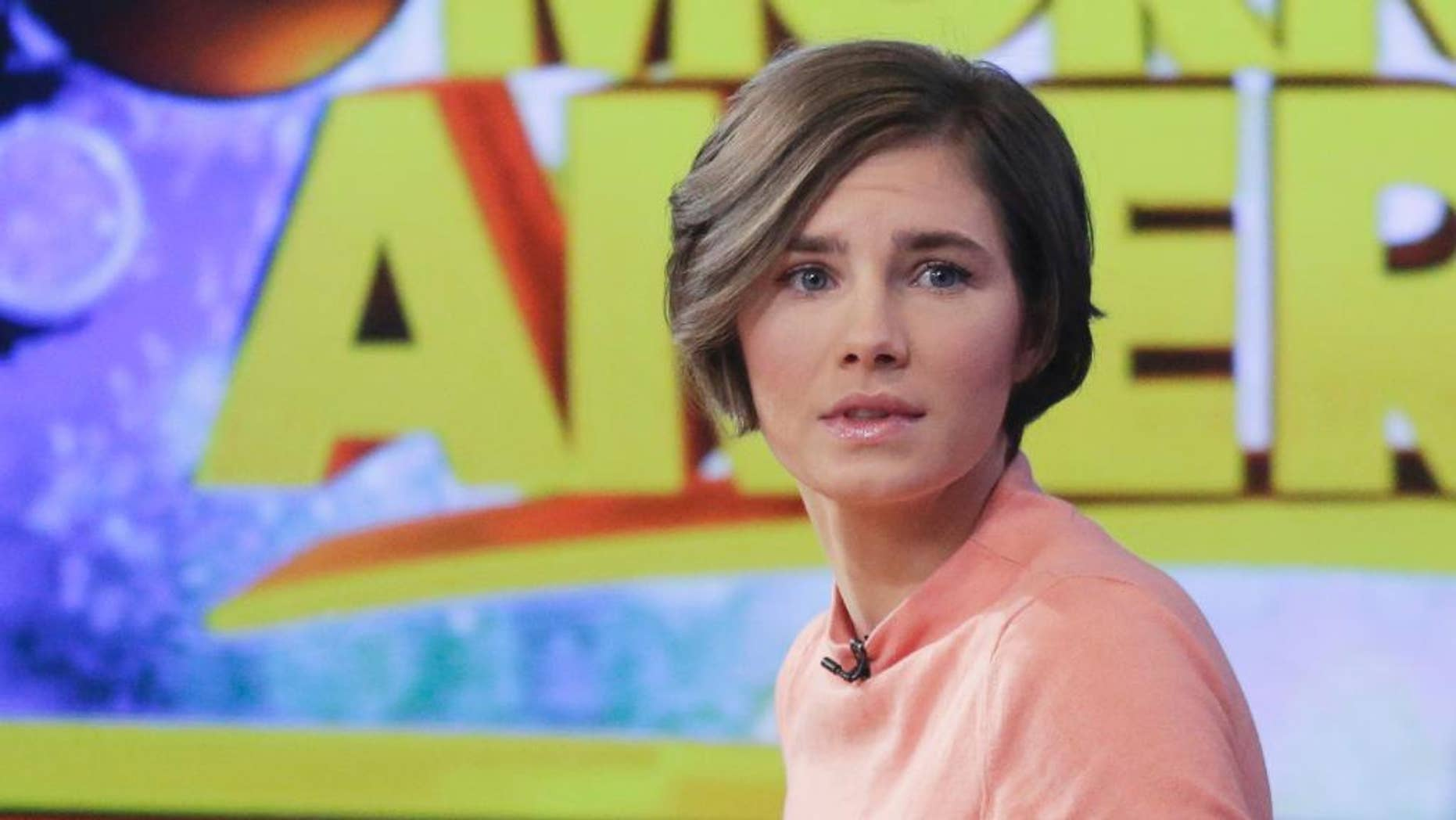 FILE - In this Jan. 31, 2014, file photo, Amanda Knox prepares to leave the set following a television interview in New York. Knox is engaged to Colin Sutherland, a musician who recently moved to Seattle from New York, a person close to the Knox family confirmed for The Associated Press. Knox's murder conviction in the 2007 stabbing of her roommate has been reinstated by an Italian court, but the former college exchange student maintains her innocence and vows she won't willingly go back to Italy. Both Knox and Sutherland are 27. No wedding date had been set. (AP Photo/Mark Lennihan, File)