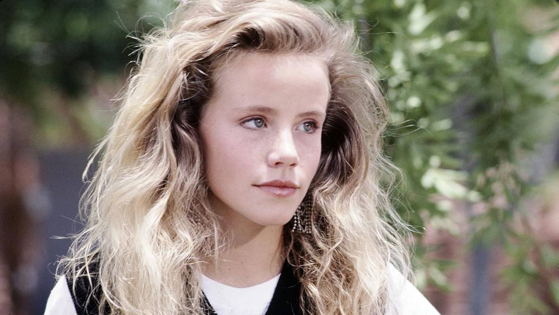 "File-This undated file photo provided by Disney shows actress Amanda Peterson in ""Can't Buy Me Love.""  The death of Peterson, best known for her role in the 1987 romantic comedy ""Can't Buy Me Love,"" was the result of an accidental morphine overdose. The autopsy and toxicology report released Wednesday, Sept. 2, 2015, by the Weld County Coroner's Office concluded that Peterson, 43, ingested a friend's morphine medication for unspecified pain a week before her death. (Copyright Disney via AP, File)"