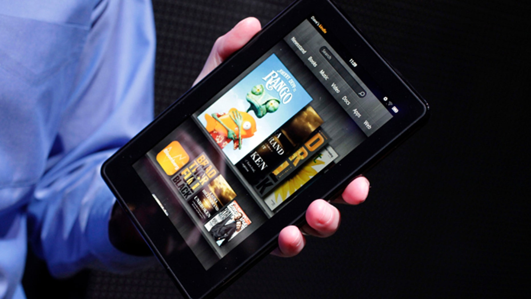 The original Kindle Fire is introduced at a news conference in New York on Sept. 28, 2011. Amazon.com quenched the Kindle Fire on Aug. 30, 2012, saying its first tablet computer is now sold out. The Internet retailer is widely expected to reveal a new model of the Fire Thursday.