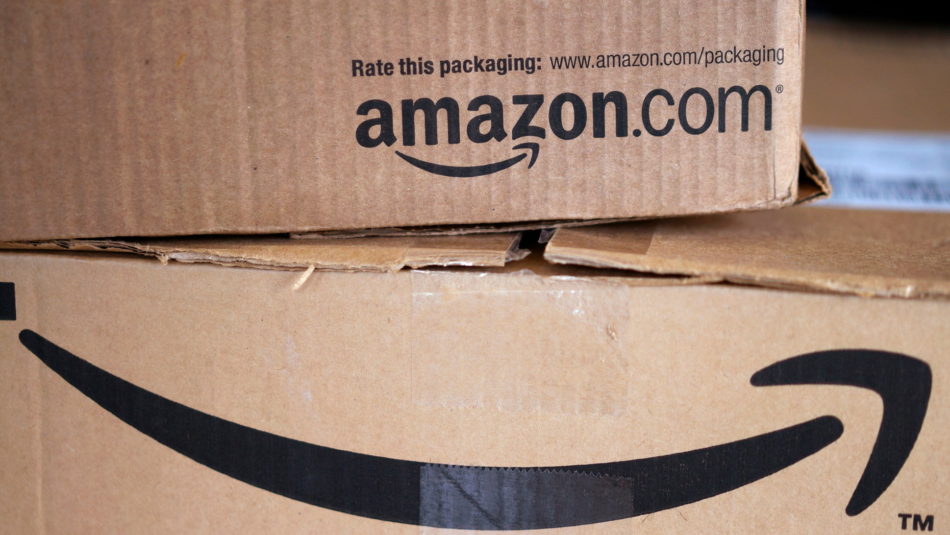 Two freshly delivered Amazon boxes are seen on a counter in Golden, Colorado August 27, 2014. With people increasingly accessing the Internet from smartphones and tablets, online companies ranging from social networks such as Facebook Inc to e-commerce companies like Amazon.com Inc have been investing heavily to develop their mobile platforms.  REUTERS/Rick Wilking (UNITED STATES - Tags: BUSINESS SCIENCE TECHNOLOGY TELECOMS) - RTR44130