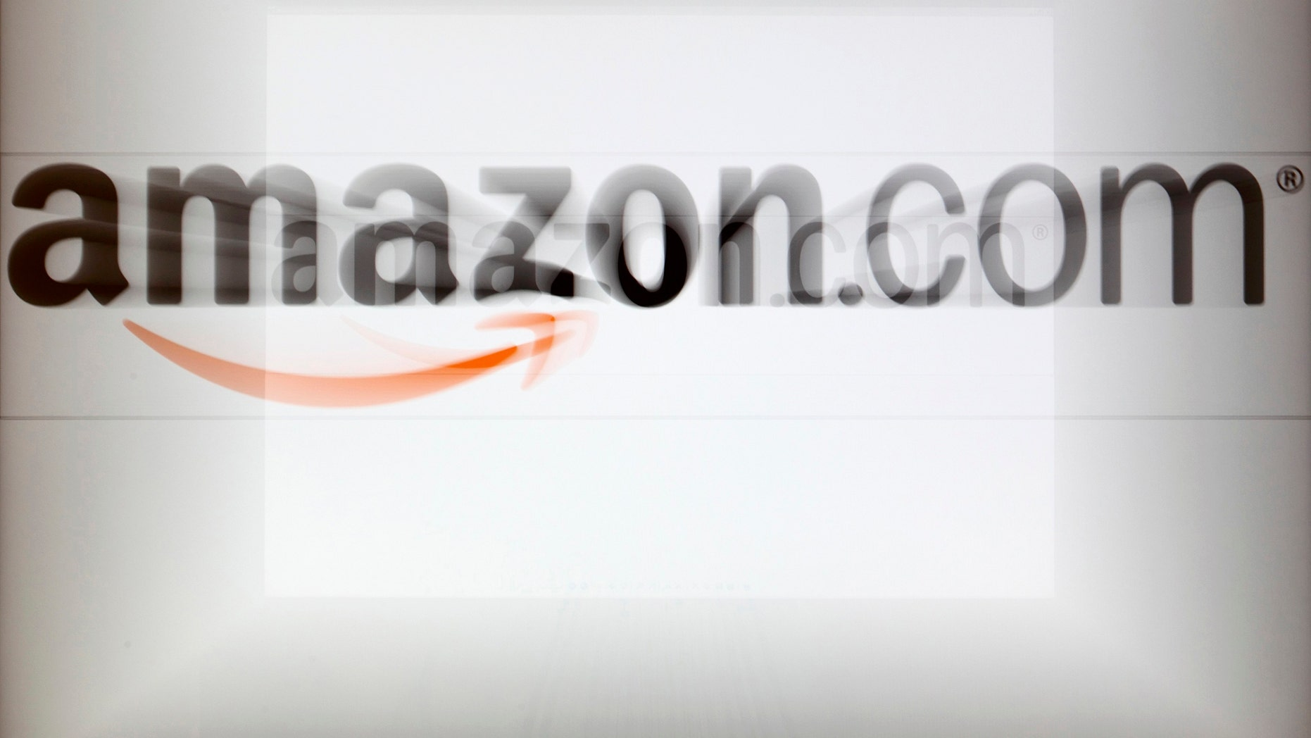 A zoomed image of a computer screen showing the Amazon logo is seen in Vienna November 26, 2012. To match Special Report TAX-AMAZON/   REUTERS/Heinz-Peter Bader (AUSTRIA - Tags: POLITICS BUSINESS) - RTR3B9FF